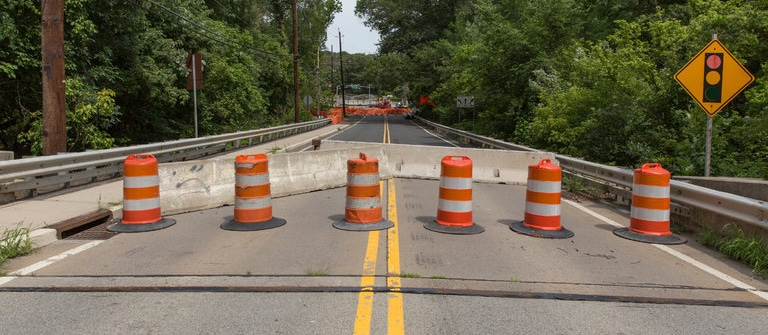 image of a road closed with cones
